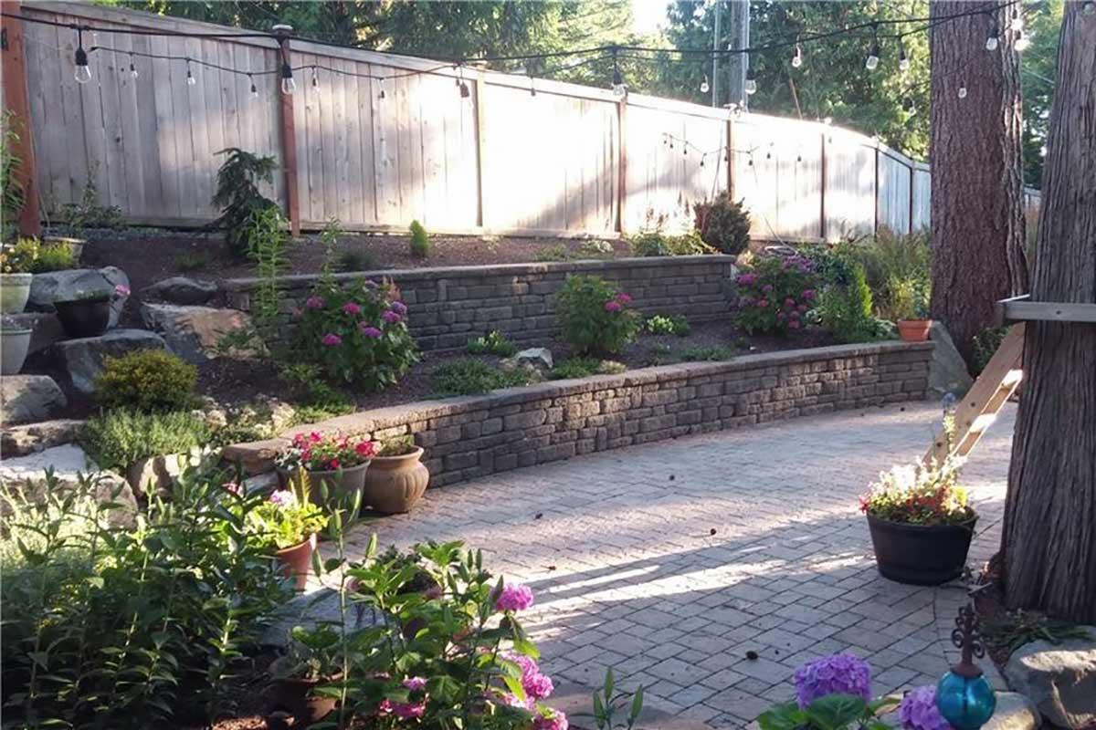 Celtik retaining wall, Dominion Slate paver patio and rockery